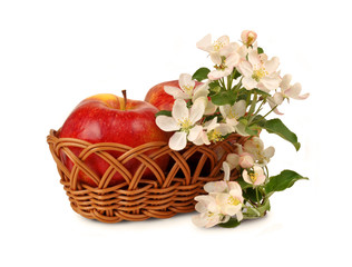 Big apple in a wicker basket and flowers