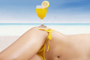 Fresh drink on the beautiful body