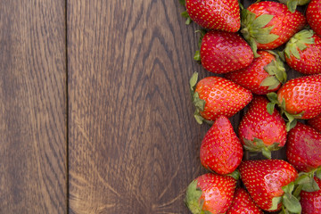 strawberry spread on brown wooden surface