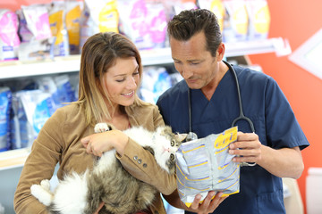 Veterinarian giving advice on pet food