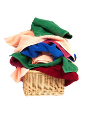 pile of towels in a basket isolated on white background