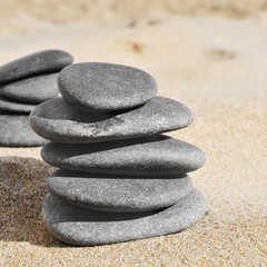 stacks of stones on the sand of a beach