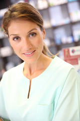 Portrait of smiling pharmacist woman in drugstore