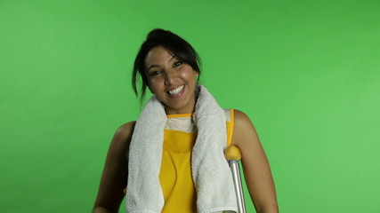 Sport woman isolated green screen confident with crutch