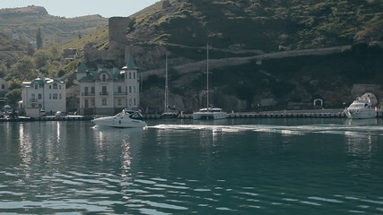 Beautiful yacht goes through harbour of the Black sea on the