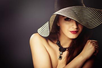 sexy woman portrait in hat at dark background