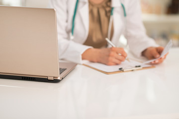 Closeup on medical doctor woman working in office