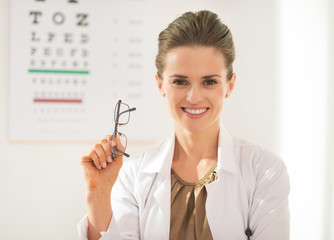 Happy ophthalmologist doctor woman with eyeglasses