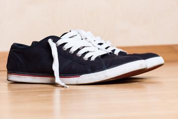 Mans blue sneakers