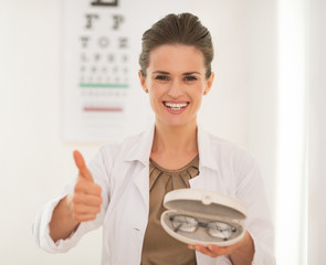 Ophthalmologist doctor woman with eyeglasses showing thumbs up