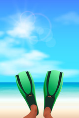 Snorkeler lying on a tropical beach with green  fins