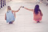 summer teens girls sitting on skateboards