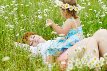 family in daisy field