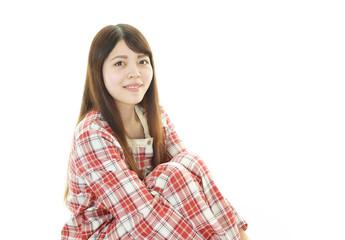 パジャマ姿の女性