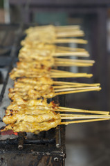 Pork satay on grilled stove.