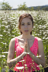 Young caucasian woman meditating in nature