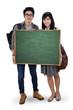 Two student holding empty blackboard