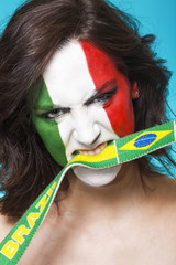 Italian supporter for FIFA 2014 biting Brazil flag