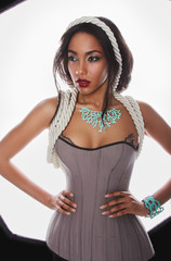 Beautiful mulatto in lingerie corset ropes and blue corral
