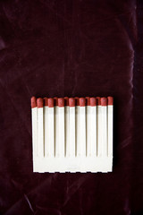 matches on deep red background