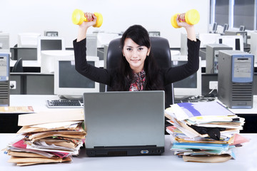 Woman working and workout in office 2