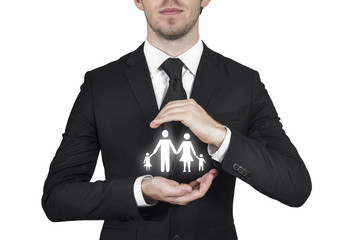 businessman protecting family paper cut with hands