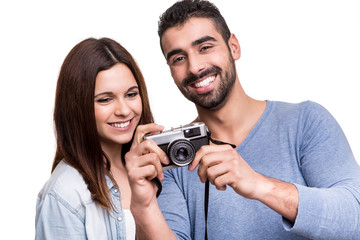 Couple taking retro camera photo