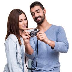 Couple taking retro camera photo
