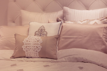 Plush soft tone pillows on bed