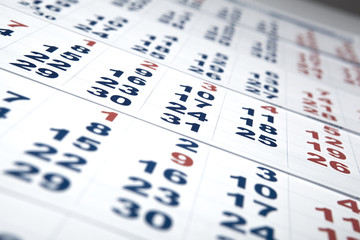 sheets of wall calendar with the number of days