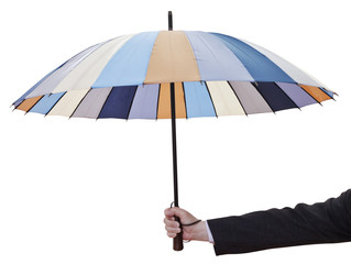 man's hand with open striped umbrella