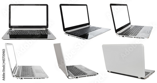 Leinwanddruck Bild set of laptops with cut out screens