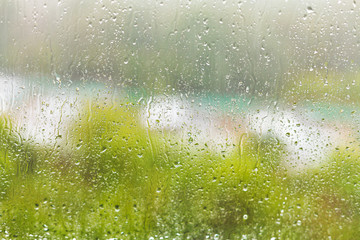 raindrops on windowpane in summer day