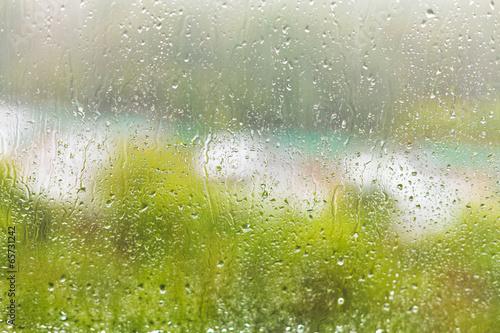 raindrops on windowpane in summer day