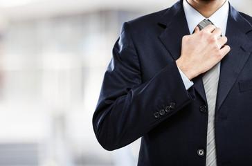 Businessman adjusting his necktie