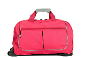 Pink luggage with wheels