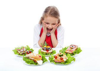 Little girl with creative party sandwiches
