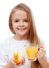 Happy girl with fresh orange juice