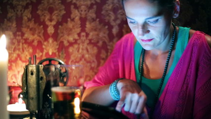 Woman with tablet sitting in a pub, steadycam shot