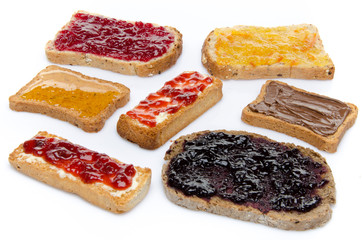 Some toasts with jams, honey and hazelnut spread