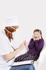 Doctor with syringe needle and girl scared
