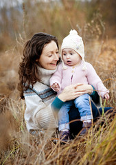 Mother with her daughter in autumn nature