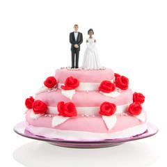 mixed couple on top of wedding cake