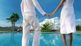 Romantic couple overlooking their dream villa