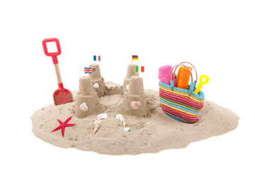 Sandcastle and toys at the beach