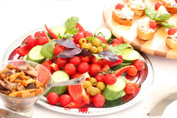 outdoor buffet with salads, appetizers, pickles, sandwiches