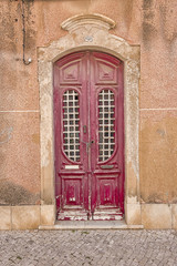 dark red door in ancient portuguese town of faro