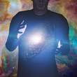 Man holds galaxy between his hands