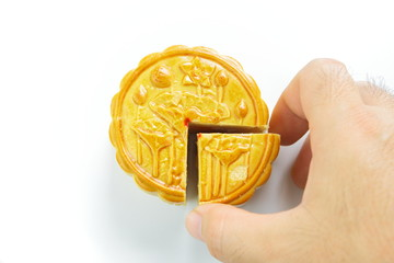 Moon cake and hand is picking