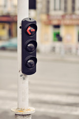 Red traffic light on a pole
